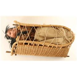 Papoose in Straw Carrier