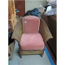 Antique wicker chair, apolstered seat with springs