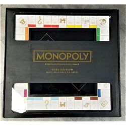 DELUXE EDITION MONOPOLY FAST DEALING PROPERTY TRADING GAME BLACK AND GOLD