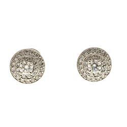 EARRINGS: Platinum earrings; (62) round brilliant cut diamonds, 1.0mm-3.4mm = an estimated  0.60 tot
