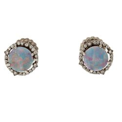 EARRINGS: 18k white gold earrings; (2) round opal doublet, 8.9mm, one is crazed; (48) round brillian