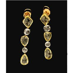 EARRINGS:  [1 pair] 14 karat yellow and white gold earrings set with round, kite and pear shape rose