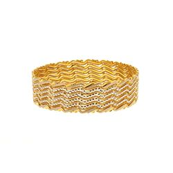 "BRACELET: [1] Lady's 22kt flat bangle bracelet; partially white plated; 17.22mmW x 2.4"" OD, round sh"