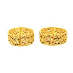 "BRACELETS: [2] Lady's 22kt pierced flat bangle bracelets; 1.0"" wide, oval shape; 100.00 grams."