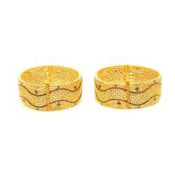 """BRACELETS: [2] Lady's 22kt pierced flat bangle bracelets; 1.0"""" wide, oval shape; 100.00 grams."""