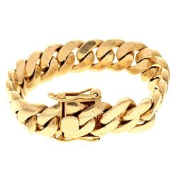 "BRACELET: [1] 10kt yellow gold curb link bracelet, 17MM wide, 9"" long; 160.1 grams"