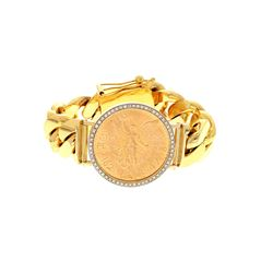 BRACELET: [1] 14 karat yellow gold Cuban chain bracelet set with a Mexican Gold 50 Pesos  (37.5 gram