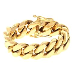 BRACELET: [1] 14ky stamped Cuban link bracelet, 8.5 inches long, 20.83mm wide; 275.4 grams.