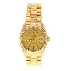 ROLEX: 18 karat yellow gold Rolex Oyster Perpetual DayDate President watch, 36mm case, gold dial wit