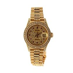 WATCH: [1] Lady's 14KYG date wristwatch with Rolex movement ;SN #2369276, movement #2235, diamond di