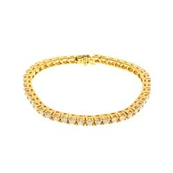 BRACELET: [1] 14 karat yellow gold tennis style bracelet set with 45 round diamonds, approx. 6.75 ca