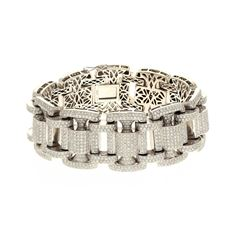 BRACELET: [1] 14KWG bracelet, 9 1/2 inch, with 1900 rbc diamonds, 28.50 cts. TWA, SI1/I. 189.0 grams