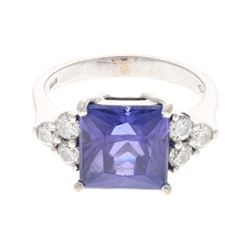 RING: 18 karat white gold stamped ring, size 6.50; (1) princess tanzanite, 9.55mm x 9.36mm x 6.84mm