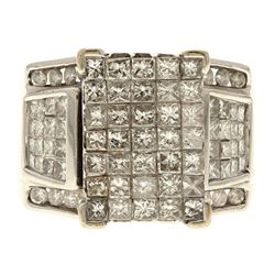 RING:  [1] 14 karat white gold ring set with 16 round and 67 princess cut diamonds, approx. 4.13 car