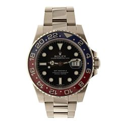 ROLEX: 18k white gold Rolex GMT Master II watch; 40mm case, black dial, bidirectional rotating blue