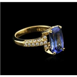18KT Yellow Gold 3.89 ctw Tanzanite and Diamond Ring
