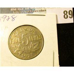 1928 Canada Nickel, slightly better grade.