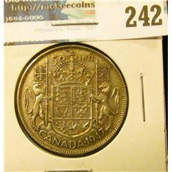 1947 Straight 7 Canada Silver Half-Dollar. VF.
