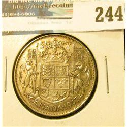 1947 Curved 7 Canada Silver Half-Dollar.
