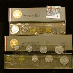"TWO FRENCH MONNAIE DE PARIS PIECES ""FLEUR DE COINS"" COIN SETS. ONE IS DATED 1964 AND HAS A SILVER FI"
