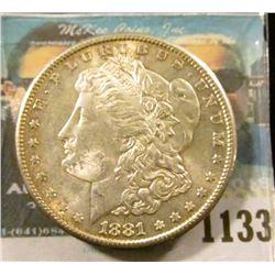 1133 _ 1881 S U.S. Morgan Silver Dollar, Gem BU with original toning.