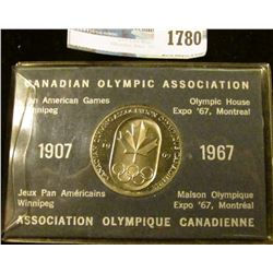 1780 _ Canadian Olympic Association 1967 Olympic Coin With Holder.  On The Front Is The Canadian Map