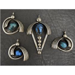 FOUR NAVAJO PENDANTS