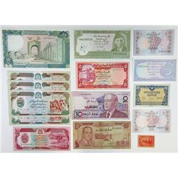 Assorted Middle Eastern Issuers. 1940s-1990s. Group of 24 Issued Notes.