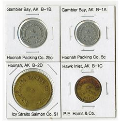 Quartet of Trade Tokens from Gambier Bay, Hawk Inlet, and Hoonah