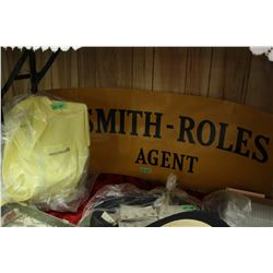 Smith Roles Sign and a Golf Shirt