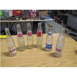 6 Pop bottles, Kik, 2 Royal Crown, diet rite Cola, Mission, Stubby