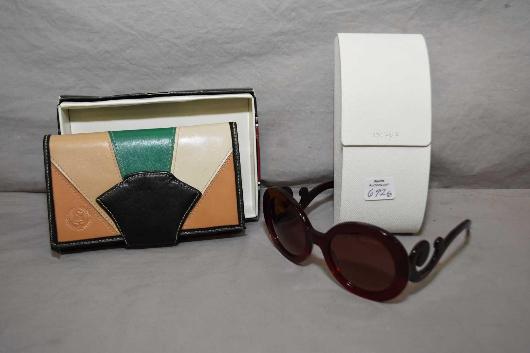 d2ad6bcb9bc5 Image 1 : Pair of Prada sunglasses in original case and a David Galindo  leather wallet