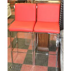PAIR OF RED LEATHERETTE AND CHROME BAR STOOLS