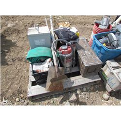 Pallet of irrigation hoses, dry commercial fire extinguisher, air meter for testing concrete, shovel