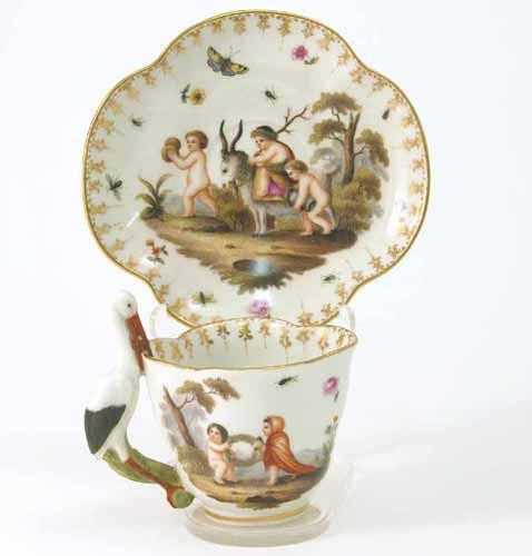 A Meissen cabinet cup and saucer, of lobed shape, cup with