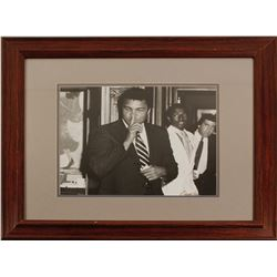 Mohammad Ali having fun with photographer Charles Adams