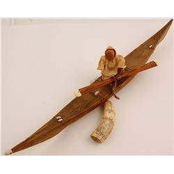 Vintage Inuit sculpture of Man in Kayak