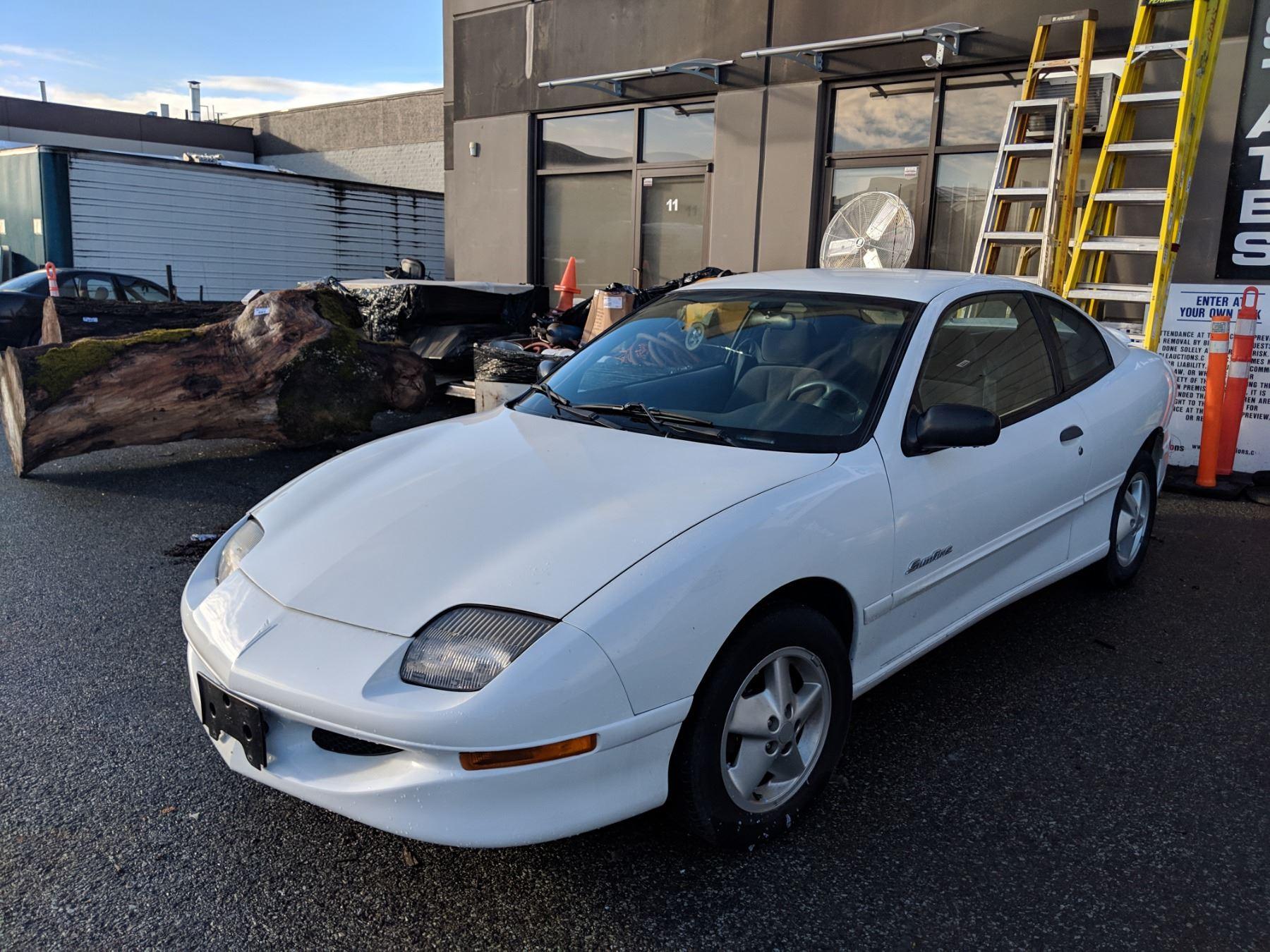 1999 pontiac sunfire white 2drcp gas automatic vin 1g2jb1249x7545950 206 513kms 1999 pontiac sunfire white 2drcp gas