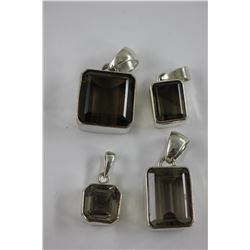 FOUR SMOKEY QUARTZ PENDANTS - TWO EMERALD/SQUARE CUT, TWO EMERALD CUT - SET IN HEAVY STERLING