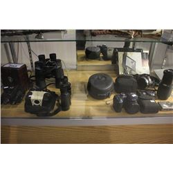 LARGE ASSORTMENT OF DIGITAL CAMERAS, BINOCULARS, HEADPHONES, AND SONY EREADER