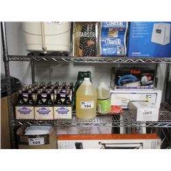 SHELF OF ASSORTED DRINKS, CLEANING PRODUCT, T-FAL STEAMER, KWIKSET POWERBOLT 2