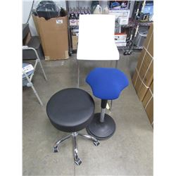 WHITE OVER HEIGHT CHAIR, BLACK STOOL ON WHEELS  CHAIR, BLUE BALANCE SEAT