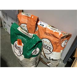 2 BAGS OF CHICKEN FEED & 1 BAG OF SHEEP FEED