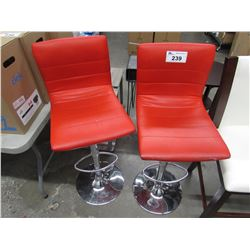 2 RED FAUX LEATHER & METAL BAR STOOLS (SOME COSMETIC DAMAGE)