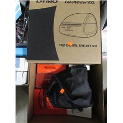 BOX OF DYMO LABELWRITER 4XL, SENNHEISER HEADPHONES, WYZECAM CAMERA, FITBIT WATCH BAND, HDMI