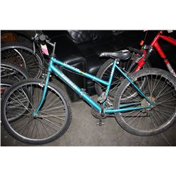 TURQUOISE TRIUMPH 15-SPEED MOUNTAIN BIKE