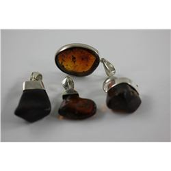 4 AMBER PENDANTS, CHERRY RED FIRE, FREE FORM SET IN STERLING SILVER