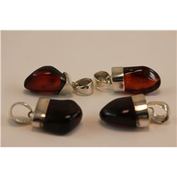 4 AMBER PENDANTS, CHERRY RED FIRE, FREE FORM, SET IN STERLING SILVER