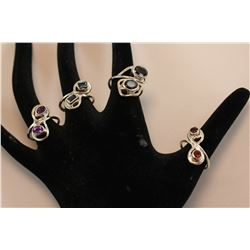4 STONE INFINITY STYLE RINGS EACH WITH 2 STONES: ONE TOURMALINE, BLUE FIRE COLOR, TWO GARNET, RED