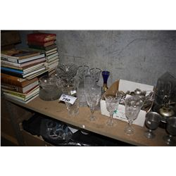 SHELF LOT INCLUDING BOOKS, CRYSTAL, SILVERWARE AND MORE